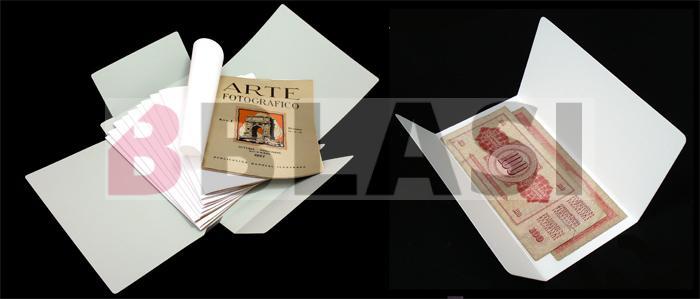 Fundes i capses de conservació fetes a mida per a unes revistes i per a un bitllet moneda.