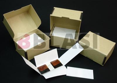 Fundes i capses de conservació fetes a mida i elaborades específicament amb productes de conservació per a material fotogràfic