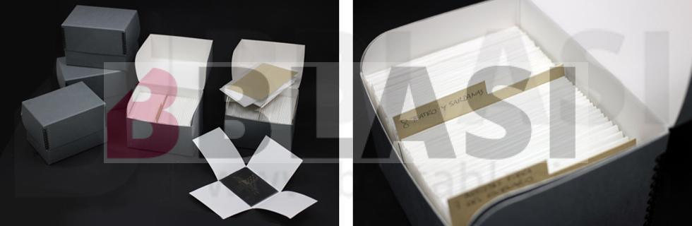 Restauració de negatius fotogràfics sobre plaques de vidre. Capses de conservació i sobres de quatre solapes que han passat el Photographic Activity Test